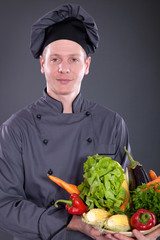 chef holding a basket of delicious fresh vegetables