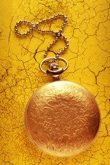 Golden pocket watch with chain