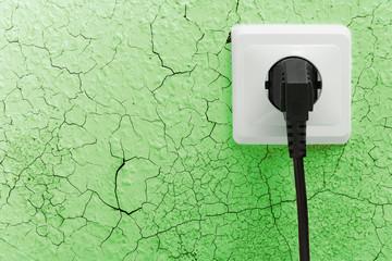 Wall plug socket on cracked wall