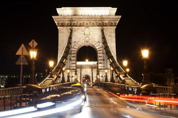 Szechenyi Chain Bridge at night with cars, Budapest