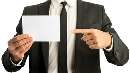 Businessman pointing to a blank card