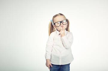 Cute little girl with glasses on a white background