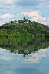 Castle Hnevin in Czech city Most with water refections