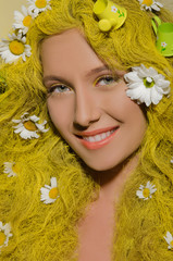woman with yellow hair and daisies