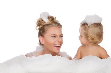 Smiling mother with her daughter and soap foam