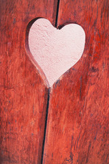 Close-up of a wooden board with a picture of the heart