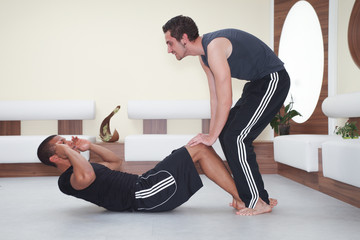 Fitness Training - man doing sport excercise