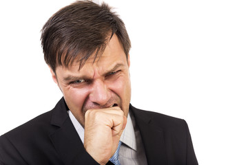 Angry businessman biting his fist