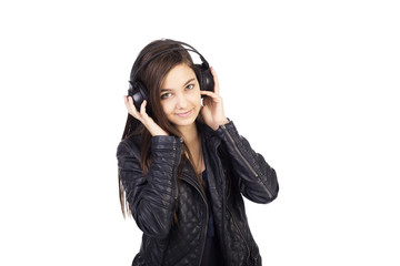 Portrait of cute  teenage girl  with headphones  listening music