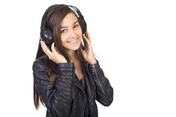 Portrait of cute teenage girl  listening music on her headphones