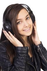 Pretty teenage girl  listening music on her headphones
