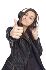 Portrait of happy cute  girl  with headphones listening music an