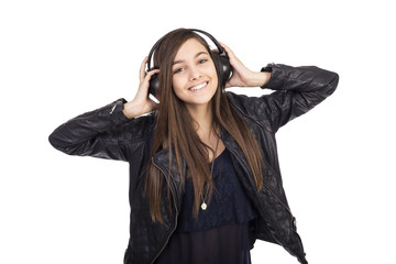 Portrait of happy cute  girl  listening music on her headphones