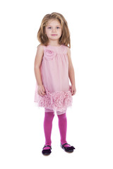 Full length portrait of an adorable little girl with pink dress