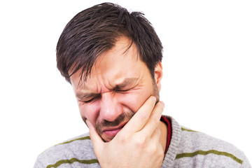 Young man suffering from a terrible tooth ache