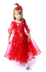 Adorable little princess in a long bright red dress.