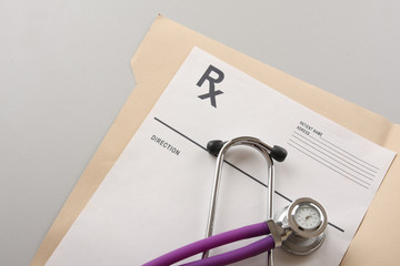 a stethoscope on a medical record