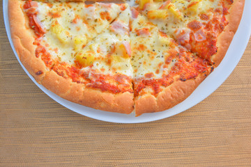 Hawiian pizza hot from oven