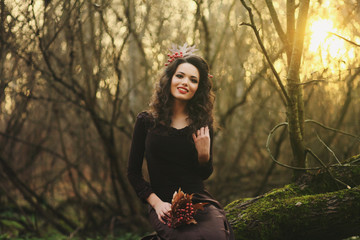 portrait of a smiling girl in a mysterious forest