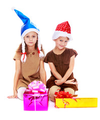 two cute sisters in Christmas hats are considering gifts.
