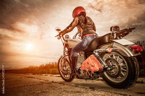 Biker girl on a motorcycle - 76725747