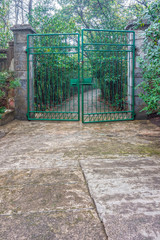 The green iron gate and the path way to park