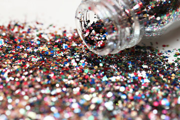 Close up view of bottle full of colorful glitters