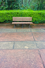 A wooden bench for relaxation in the garden of Memorial Hall gar
