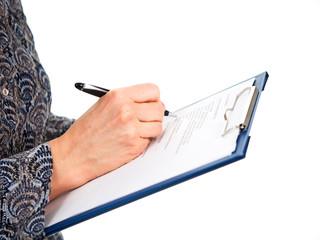 Hand mit Schreibunterlage