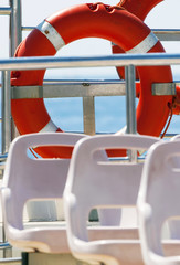 Lifebuoy on a yacht side. Concept of safe sea walk.