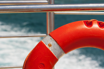 Lifebuoy on a yacht side. Concept of safe sea walk.