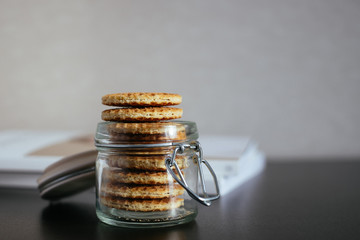 Stack of dutch waffles with caramel in a jar
