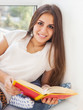 Beautiful teen girl reading a book