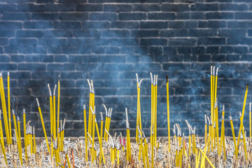 Burning joss sticks and smoke in Buddhist temple