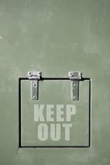Green metal door, keep out