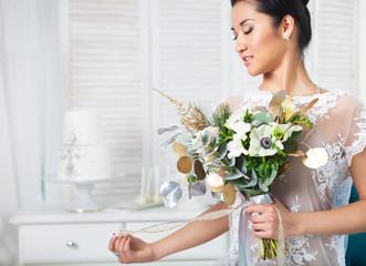 Unusual wedding bouquet at hands of a bride