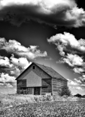 Old desolate barn with storm clouds overhead