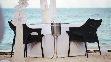 Served empty table on the shore in black and white colors