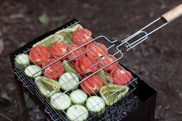Sliced tomatoes on barbecue grill