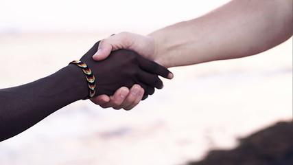 Hand shake as symbol of international friendship