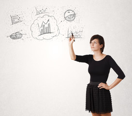 Young lady sketching financial chart icons and symbols