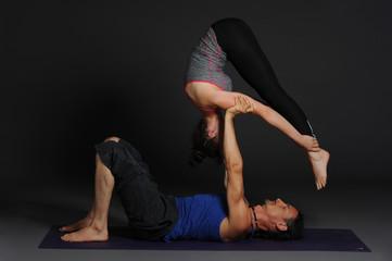 Woman and man doing acro yoga