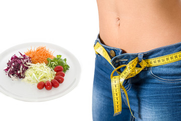 young girl wearing jeans after diet and food background