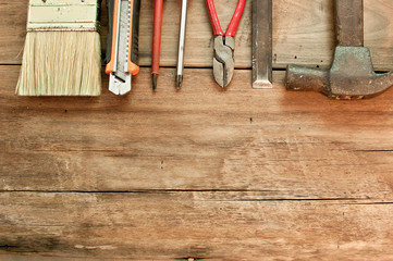 Various tools on a wooden floor.