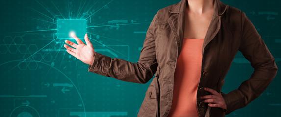 Woman pressing high tech type of modern buttons