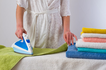 housewife  ironing towels