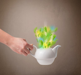 Tea pot with leaves and colorful abstract lights