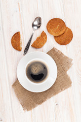 Coffee cup, gingerbread cookies and spoon