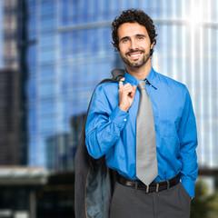 Businessman holding his jacket