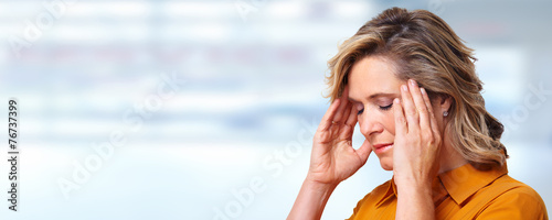 Woman having headache migraine. - 76737399